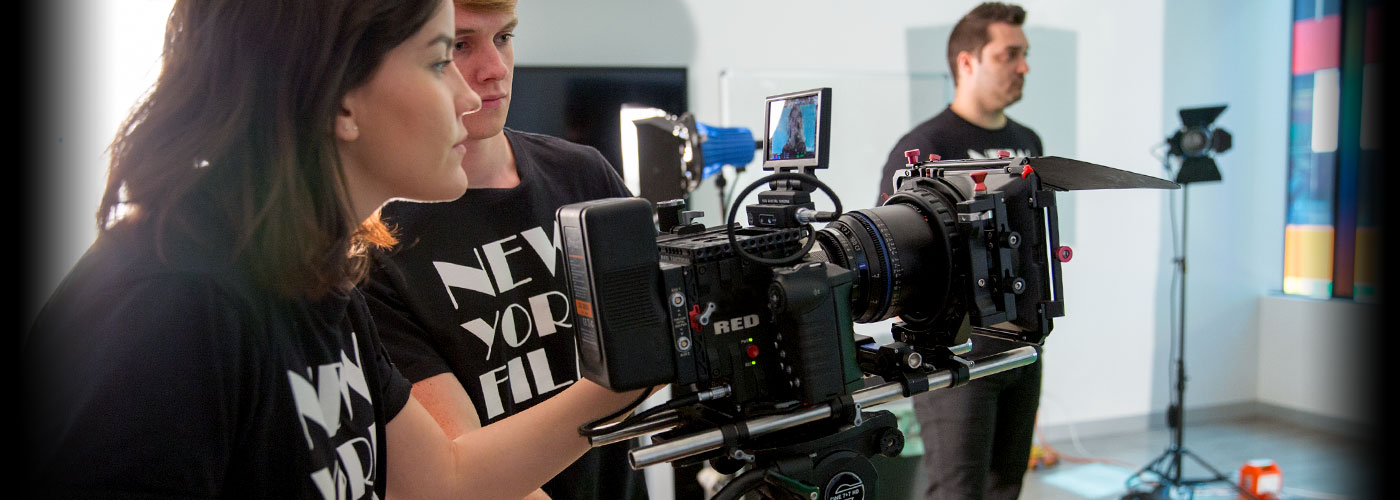 NYFA Student using a camera on set