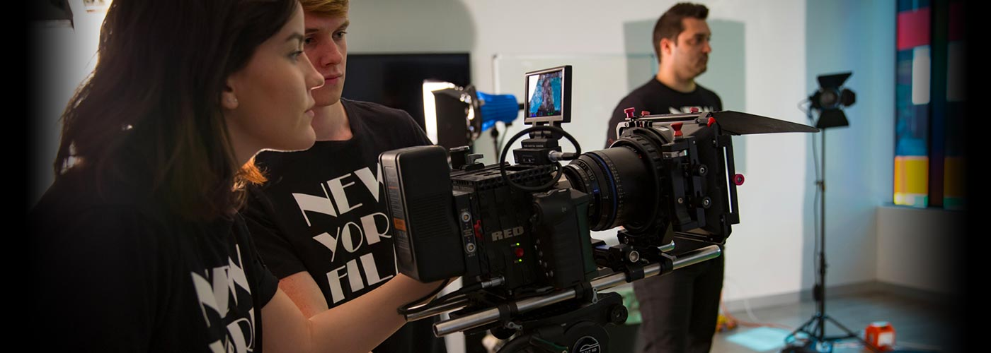 NYFA Students observing a film scene through a RED camera
