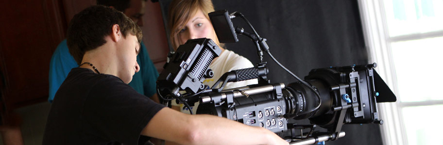 NYFA film camp student adjusts camera on set